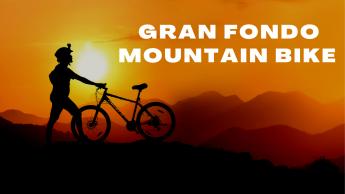 Uomo con bicicletta su sfondo tramonto